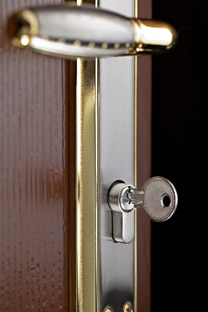 Lock Inserted in a Keyhole Stock Photo
