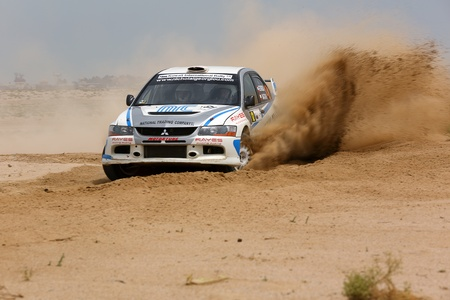SAFIR, KUWAIT - April 13: A Mitsubishi #12 participates in the Kuwait International Rally organized by The Quarter Mile Motorsports Club (QMMC) & Motorcycle Club on April 13, 2012 in southern Kuwait. Editorial