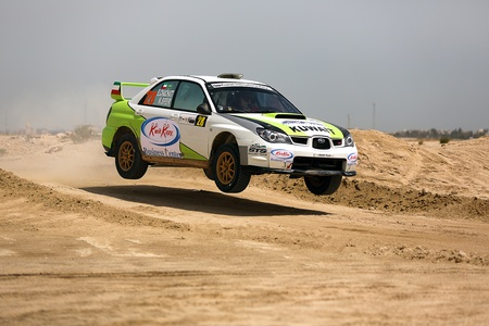 SAFIR, KUWAIT - April 13: Subaru Impreza #28 driver Elie Chachati and co-driver Naji Sfeir participates in the Kuwait International Rally organized by The Quarter Mile Motorsports Club (QMMC) & Motorcycle Club on April 13, 2012 in southern Kuwait.