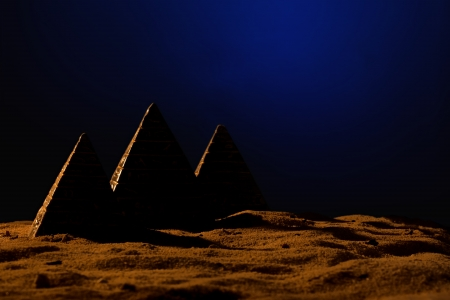 Three small pyramids on the sand Stock Photo