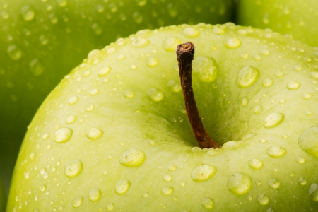 Closeup of a green Granny Smith Apple with water droplets Stock Photo