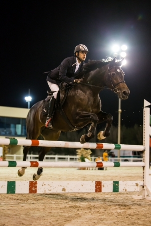 WISTA AREA, KUWAIT - NOVEMBER 16: An unknown male rider participates in horse jumping competition on November 16, 2012 in Kuwaits  Messilah Equestrian Club.
