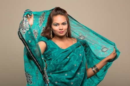 Portrait of a woman wearing a green sari Stock Photo
