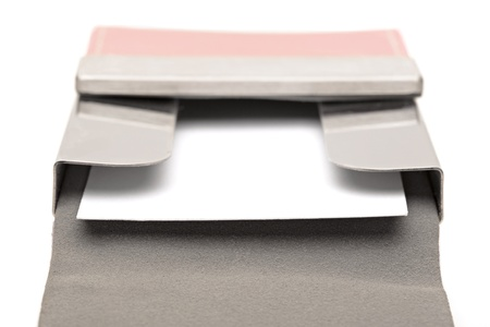 Open Pink leather business card holder with a white business card Stock Photo