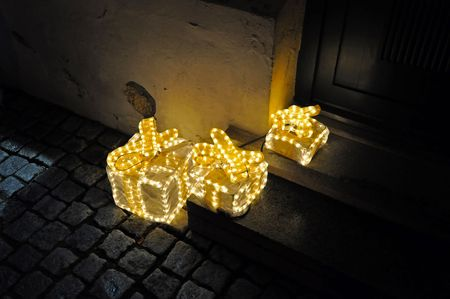 Three outdoor lightning Christmas boxes.