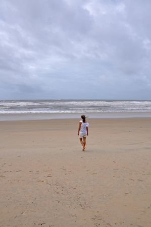 Young woman on stormy beach, picture taken on Goa, India. Stock Photo - 7535233