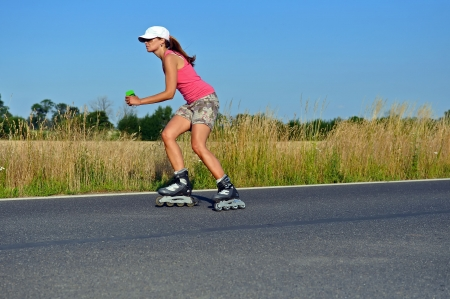 Young woman rollerskating photo