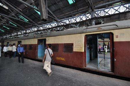 railway history: Mumbai, India - 5 November, 2009: Train reserved only for ladies stops at Chhatrapati Shivaji Terminus (CST) on November 7, 2009. CST, formerly Victoria Terminus, is one of the busiest railway stations in India.   Editorial