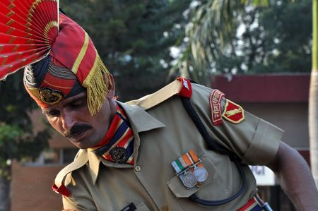 wagah: Wagah border, Punjab, India - 25 October, 2009: Member of indian Border security force guards during the everyday ceremonial on indo-pakistan border on October 25, 2009