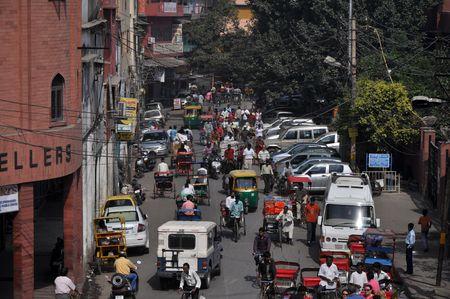 narrow street: OLD DELHI, INDIA - 24 OCTOBER, 2009: Traffic jam with rickshaws, motorbikes, cars and pedestrians on local city street on October 24, 2009. Traffic jam is the main problem of transportation in Delhi.