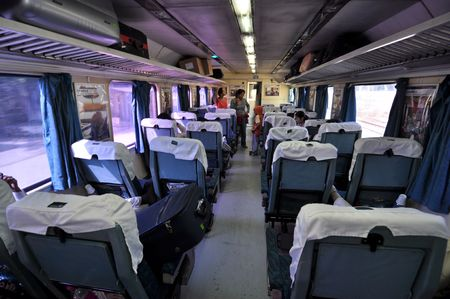 first move: NEW DELHI, INDIA - 25 OCTOBER 2009: Interior of first class in Shatabdi Express Train on its way from New Delhi to Amritsar on October 25, 2009. The Shatabdis are the most luxurious and the fastest trains in India. Editorial