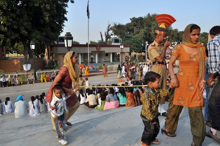 wagah: WAGAH BORDER, INDIA � 25 OCTOBER, 2009: Rich indian visitors enter the VIP ceremonial sector on indo-pakistan border on October 25, 2009. Ceremonial is famous for opening and closing the gate between both states.