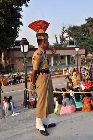WAGAH BORDER, INDIA - 25 OCTOBER, 2009: Member of indian Border security force guards during the ceremonial on indo-pakistan border on October 25, 2009. Ceremonial is famous for closing the gate between both states. Stock Photo - 7737926