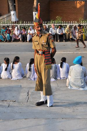 WAGAH BORDER, INDIA - 25 OCTOBER, 2009: Member of indian Border security force guards during the ceremonial on indo-pakistan border on October 25, 2009. Ceremonial is famous for closing the gate between both states. Stock Photo - 7737927