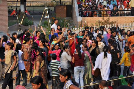 WAGAH BORDER, INDIA - 25 OCTOBER, 2009: An unidentified group of indian women and children dance on indo-pakistan border street on October 25, 2009. It celebrates the ceremonial of closing the gate between India and Pakistan. Stock Photo - 7737928