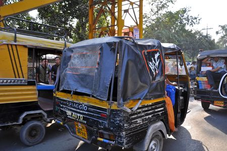 autorick: OLD DELHI, INDIA - 25 OCTOBER, 2009:  An unidentified group of Indian people travel by tuk tuk in Old Delhi on October 25, 2009. Typical mileage for an Indian-made auto rickshaw is around 35 kilometers per liter of petrol.