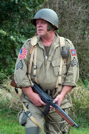 weaponry: American soldier with submachine gun, second world war style.