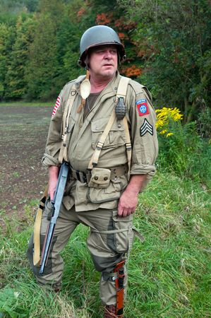 American soldier with submachine gun, second world war style. photo
