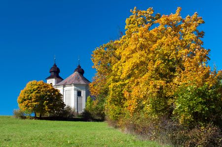 Baroque chapel during the autumn time, sunny day. photo
