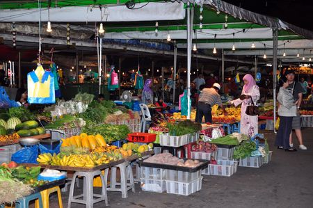 night market: BRUNEI - 30 APRIL, 2010: An unidentified people buy vegetable, fruit and food on market in Brunei on April 30, 2010. These markets are known for cheap prices and high quality of goods.