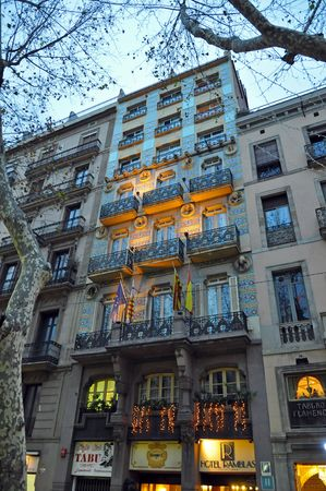 BARCELONA, SPAIN - 29 DECEMBER, 2009:  The picture of a Rambla Hotel on La Rambla street on December 29, 2009.  The street in the heart of Barcelona is famous for hotels, shopping, eating and is also notorious for professional pick pockets.