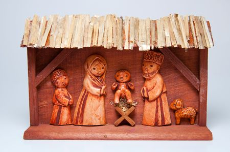 Picture of wooden christmas crib, handcarved, horizontal shot. photo