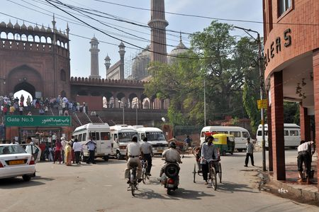 OLD DELHI, INDIA - 24 OCTOBER, 2009: Vans wait for tourists on the street in Delhi in the front of Jama Masjid Mosque on October 24, 2009. Jama Masjid is the principal mosque of Old Delhi in India.