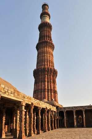 Qutub Minar Tower in Delhi during the afternoon, India. photo