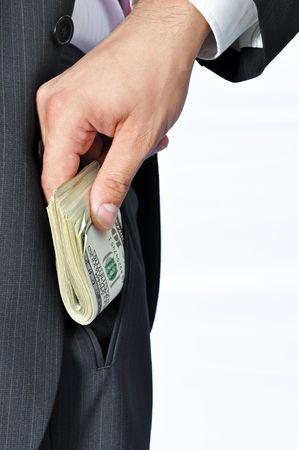 Giving a bribe into a pocket, vertical shot.