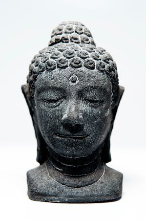 detachment: Buddha face with eyes closed in prayer, isolated over white background.