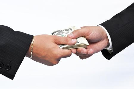Two businessmen and paying money, horizontal shot. photo