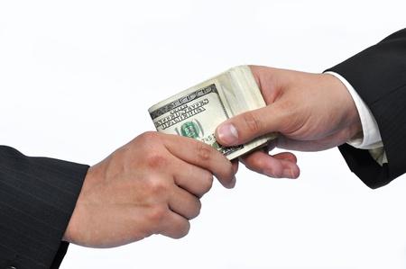 corrupcion: Dos hombres de negocios y pago de dinero, tiro horizontal.  Foto de archivo