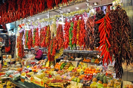 boqueria: BARCELONA, SPAIN - 29 DECEMBER, 2009: Vendors and their goods on La Boqueria market in Barcelona on December 29, 2009. The market is famous for its variety of fresh produces.