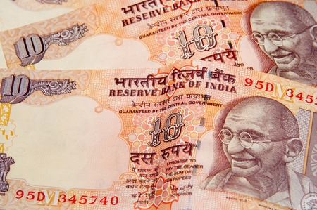 rupees: Indian rupee notes with portraits of Gandhi. Stock Photo