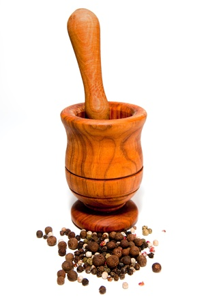 black peppercorn: Wooden mortar and a pestle isolated on a white background. Stock Photo