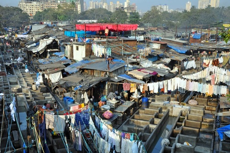 DELHI, INDIA - 5 NOVEMBER, 2009: An unidentified Indian people work at Dhobi Ghat in Mumbai on November 5, 2009. Dhobi Ghat is the the worlds largest outdoor laundry and work there nearly 200 dhobi families.