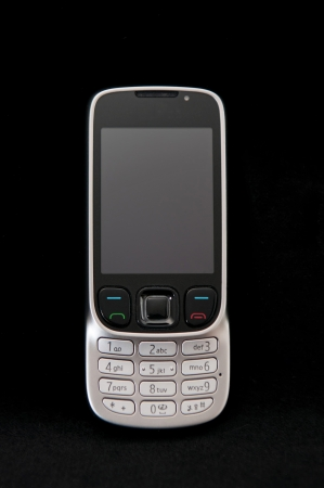Trendy cell phone on a black background. photo
