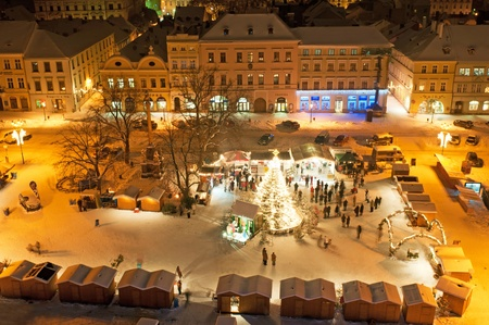 LITOMERICE, CZECH REPUBLIC - 19 DECEMBER 2010: An unidentified group of people enjoy Christmas market in Litomerice on December 19, 2010. One of the highlights of the market is Gluhwein, hot mulled wine.