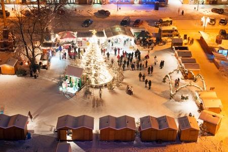 LITOMERICE, CZECH REPUBLIC - 19 DECEMBER 2010: An unidentified group of people enjoy Christmas market in Litomerice on December 19, 2010. One of the highlights of the market is 'Gluhwein', hot mulled wine. Stock Photo - 8465115