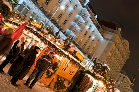 DRESDEN, GERMANY - 20 DECEMBER 2010: An unidentified group of people enjoy Christmas market in Dresden on December 20, 2010. It is Germany's oldest Christmas Market with a very long history dating back to 1434. Stock Photo - 8485181