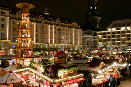 DRESDEN, GERMANY - 20 DECEMBER 2010: Tourists enjoy Christmas market in Dresden on December 20, 2010. One of the highlights is eight meter high Christmas pyramid with the life size hand made wooden figures. Stock Photo - 8485151