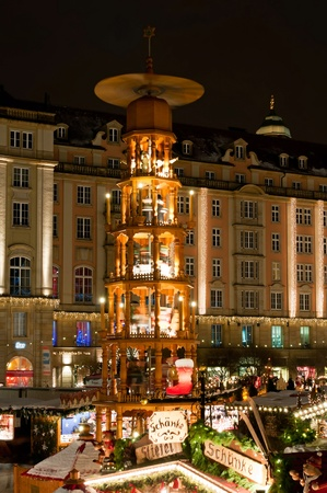 DRESDEN, GERMANY - 20 DECEMBER 2010: Picture of traditional Christmas market in Dresden on December 20, 2010. One of the highlights is eight meter high Christmas pyramid with the life size hand made wooden figures. Stock Photo - 8505423