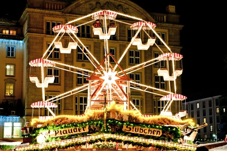 DRESDEN, GERMANY - 20 DECEMBER 2010: Picture of traditional Christmas market in Dresden on December 20, 2010. One of the highlights is a rotating giant wheel.