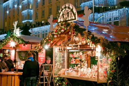 DRESDEN, GERMANY - 20 DECEMBER 2010: An unidentified group of people enjoy Christmas market in Dresden on December 20, 2010. It is Germanys oldest Christmas Market with a very long history dating back to 1434.