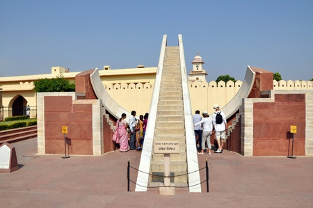 JAIPUR, INDIA - 4 NOVEMBER, 2009: Tourists admire Jantar Mantar observatory on November 4, 2009. The Jantar Mantar is a collection of architectural astronomical instruments inscribed on the UNESCO World Heritage List. Stock Photo - 8558934