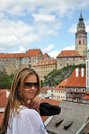krumlov: Cute caucasian model in Cesky Krumlov, Czech Republic. Stock Photo
