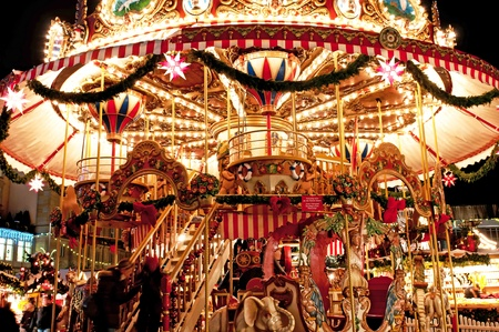 DRESDEN, GERMANY - 20 DECEMBER 2010: Picture of traditional Christmas market in Dresden on December 20, 2010. One of the highlights is a wooden merry-go-round. Stock Photo - 8632140