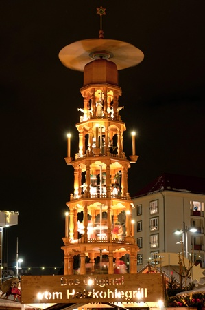 DRESDEN, GERMANY - 20 DECEMBER 2010: Picture of traditional Christmas market in Dresden on December 20, 2010. One of the highlights is eight meter high Christmas pyramid with the life size hand made wooden figures.