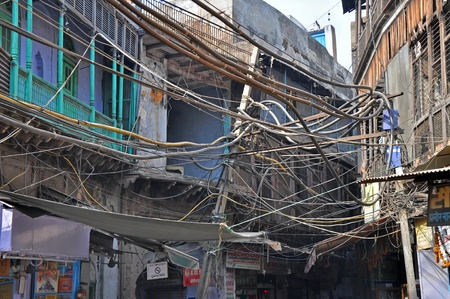 wire frame: OLD DELHI, INDIA - 24 OCTOBER, 2009: Picture of Indian chaotic electrical wiring in Old Delhi on October 24, 2009. Unsatisfying condition of wiring causes power problems in Delhi.