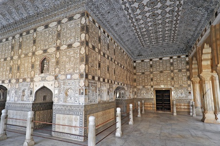 jaipur: AMBER, INDIA - 4 NOVEMBER 2009: Picture of unique interior of the Amber fort covered in thousands of tiny mirrors on November 4, 2009. Amber Fort is known for its unique artistic style, blending both Hindu and Muslim (Mughal) elements.